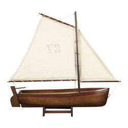 "Inviting Home - Madeira Y3 Yacht Model (honey) - Honey Madeira Y3 yacht model; 17-3/4""L x 3-3/8""W x 16-3/8""H Lateen rigged they recall a sunny day on a Portuguese beach. Madeira yacht model is colorful and hand-carved from a solid block of wood. This yacht model has slightly antique finis and is perfect for nautical home decor. Available in 3 colors * some assembly required"