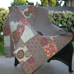 None - Stella Quilted Patchwork Throw - Snuggle in warmth with this quilted patchwork throw. The floral medallion design and geometric print of this throw will make a beautiful addition to your decor. This throw is crafted from 100 percent cotton to provide you with years of use.
