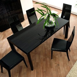 """Nightfly Extendable Dining Table - Black - Rossetto knows that the Nightfly Extendable Dining Table - Black is an experience you'll wish to share with all your friends. That's why this piece while excellent for everyday use also comes with an extendible leaf for seating up to ten. And with its real Italian craftsmanship it's easy to see why this won't be a piece you'll want to keep to yourself. A high-gloss black finishes the piece topped with glass to maintain the integrity of the grain. An angular base supports the piece upholstered in crocodile-patterned Eco-leather. Minimal assembly is required. Rossetto guarantees this product with a one-year manufacturer's warranty. This purchase is for dining table only please see """"""""Related Items"""""""" for matching chairs or complete dining set. About Rossetto USARossetto USA is the U.S. division of the Arros Group a leading manufacturer that exports Italian furniture style and design all over the world. Operating out of its warehouse in High Point N.C. since 1999 Rossetto provides complete contemporary and modern dining bedroom and occasional furniture programs that combine affordable price with innovative Italian design to satisfy the demands of their distinguished customers."""