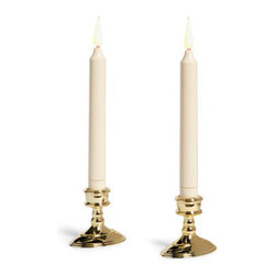 """Grandin Road - Set of Two Battery Operated Window Candles - Ivory candles and their flickering """"flames"""" are crafted from durable plastic. Each is equipped with a 6-hour timer. With a rubber stopper, each fits securely into any standard taper holder. Weighted brass-style bases and optional suction cups included. Each requires three AA batteries (not included); will last up to 50 days if candles are left in timer mode. Set a welcoming scene every night with our Battery-operated Window Candles. A built-in six-hour timer automatically turns each ivory candle on and off at the same time, making it a cinch to set your frosty panes aglow every night. Ivory candles and their flickering """"flames' are crafted from durable plastic .  .  .  .  . Recommended for indoor use only ."""