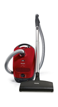 Frontgate - Miele Titan S2181 Canister Vacuum - Powerful 1,200-watt Miele-made Vortex Motor. Six-stage suction control via rotary dial. AirClean System™ with unique AirClean FilterBags™ and filter. Electric telescopic stainless steel wand. Active HEPA filter. The Miele Titan S2181 Canister Vacuum gently cares for all flooring in your home, from smooth, solid surfaces like tiles and hardwoods to low and medium-pile carpeting. This versatile vacuum includes the Electro Comfort electrobrush ideal for cleaning low to medium pile carpeting, rugs and smooth flooring. The Electro Comfort electrobrush is an electrically driven carpet tool with floating head and swivel neck design for easy maneuverability. The Titan also includes a Parquet floor tool with long, soft, natural bristles that clean tile, wood and other smooth surfaces thoroughly with extreme care. The Titan features a telescopic, stainless steel wand and long electrical cord with automatic rewind for a total cleaning radius of almost 30 feet. With six distinct power settings, it's easy to vary your vacuum cleaner's suction power according to the carpet pile, flooring and fabrics you're cleaning.  .  . AirClean System with unique AirClean FilterBags and filter .  .  . ElectroComfort mid-size electrobrush (SEB 217-3) . Parquet floor tool (SBB Parquet-3) . Deluxe handle grip with electrobrush control . Includes dusting brush, upholstery tool and crevice nozzle on VarioClip . Made in Germany.