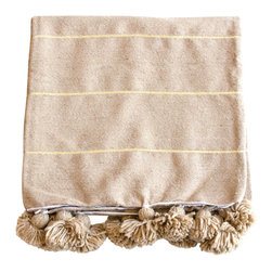 The Loaded Trunk - Moroccan Cotton Pom Pom Blanket - A new addition to our favorite wool counterparts! This 100% cotton khaki & gold striped hand loomed blanket from the souks of Marrakech is the perfect solution to those that prefer a lighter look with the same elegance. Stunning layered on any bed or couch. Cozy enough to get close to your skin!