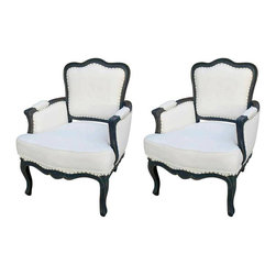 Pair of French Large Bergere Arm Chairs - French pair of over sized bergere style arm chairs. The wooden frame is hand painted in distressed black. Upholstered in off white cotton fabric. Nail heads trim shown around the frame. This pair of chairs will be a perfect addition to your French inspired Home. The price is for the pair.