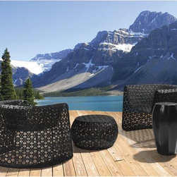 Seasonal Living Black Lace Modern Wicker Outdoor Lounge Chair - This furniture has a wonderful hand woven pattern that is subtle but effective. It looks substantial but has a lightness about it that makes it perfect for outdoor furniture.