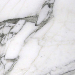 Calacatta Cloud - I love the hi-contrast, dark veins of this particular Calacatta marble. I've also see one that's similar called Calacatta Arabescato - it's important to check with your local supplier regarding names since they often vary from region to region and supplier to supplier.