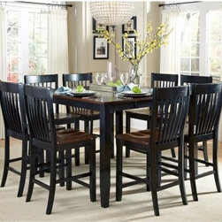 AHB Ellington 9-Piece Counter Height Dining Table Set - The AHB Ellington 9-Piece Counter Height Dining Table Set includes the dining table and eight counter height chairs to help you host an elegant dinner party. This set is built from select hardwoods with a two-tone Navajo and black finish, and the table features a butterfly leaf to provide extra dining space.American Heritage BilliardsBefore founding American Heritage Billiards back in 1987, the owners were building pool tables in high school, learning the industry from the ground up. Today their 170,000 sq.-ft.-facility, centrally located in Cleveland, Ohio, is the largest billiards manufacturer in the world, the leader in design, selection, service and value. Each item of entertainment furniture is meticulously designed and engineered to withstand the test of time, utilizing old-fashioned wood joinery methods. The vast majority of our metal products have welded joints to provide a lifetime of carefree service.