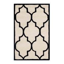 """Safavieh - Annette Hand Tufted Rug, Ivory / Black 2'6"""" X 4' - Construction Method: Hand Tufted. Country of Origin: India. Care Instructions: Vacuum Regularly To Prevent Dust And Crumbs From Settling Into The Roots Of The Fibers. Avoid Direct And Continuous Exposure To Sunlight. Use Rug Protectors Under The Legs Of Heavy Furniture To Avoid Flattening Piles. Do Not Pull Loose Ends; Clip Them With Scissors To Remove. Turn Carpet Occasionally To Equalize Wear. Remove Spills Immediately. Bring classic style to your bedroom, living room, or home office with a richly-dimensional Safavieh Cambridge Rug. Artfully hand-tufted, these plush wool area rugs are crafted with plush and loop textures to highlight timeless motifs updated for today's homes in fashion colors."""
