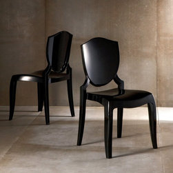Homelegance - Polycarbonate Side Chair - Black Shield - Set of 2 - 953S520Y(3A)-(2PC) - Shop for Dining Chairs from Hayneedle.com! Polycarbonate earns posh status with the Polycarbonate Side Chair - Black Shield - Set of 2 This delightful duo of chairs is constructed of tough stout polycarbonate and finished in a shiny black shade that s anything but drab. Some cool curves add a bit of elegance and the design looks cool in any setting especially contemporary. Some assembly is required.About Homelegance Inc.Homelegance takes pride in offering only the highest quality home furnishings that incorporate innovative design at the best value. From dining sets to mirrors sofas and accessories Homelegance strives to provide customers with a wide breadth and depth of selection as well as the most complete and satisfying service available for their category. Homelegance distribution centers are conveniently located throughout the United States and Canada.