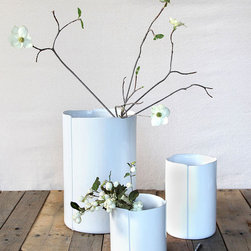 Draper Ceramic Vase - Perhaps it may hold a willow branch that is a harbinger of spring, or a posy of newly opened blossoms brushed by summer sun. With its soft coloration, satin white glaze, and minimalist design, the Draper Ceramic Vase allows the beauty of its contents to remain the focus of attention. The subtle asymmetry of the rim enhances the artisan aesthetic of the piece.