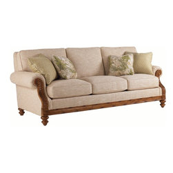 Lexington - Tommy Bahama Home Island Estate West Shore Sofa - A handsome build, timeless accents and plush comfort come together in this loose back sofa as it provides a place for unwinding and repose.Create an island oasis in your living room or family room with the West Shore Sofa. Design features include rolled arms with elegantly curled fern wood accents, traditional turned legs and bamboo inspired frame. This graceful sofa will create a casual appeal with tropical accents for your d'cor. Two 20 x 20 inch and two 18 x 18 inch blend down throw pillows provide visual contrast and comfort. Settle into the ultra down seat cushions after a long day working or playing in the sun and relax in luxurious style!