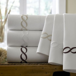 Kassatex Cable Embroidery 300 Thread Count Egyptian Cotton Sheet Set - Connect elegance and comfort with the Kassatex Cable Embroidery 300 Thread Count Egyptian Cotton Sheet Set. These exquisite 300 thread count Egyptian cotton sheets are a brilliant display of white fabric wrapped in intricate and bold cable embroidery in your choice of colors. Choose all-white beige or chocolate details to match the existing decor of your room or to define a new theme. This supremely soft and supple sheet set is machine washable. Sheet Set Components Flat sheet Fitted sheet 2 pillowcases About KassatexKassatex uses its truly global nature - it has operations in the US Portugal Turkey China India South America and more - to provide a high-quality product using only the best materials. In the US since 1999 Kassatex brings a wide range of bed and bath fabrics that are reliably as comfortable as they are surprisingly affordable.