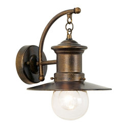 """Elk - Maritime Collection 12"""" High Outdoor Wall Light - This designer wall light is a contemporary take on the antique-style seaside motif. The classic hazelnut bronze finish is complemented by a clear very lightly seeded blown-glass. A swirled arm makes a dramatic accent. The combination of all these style elements makes this a visually-appealing outdoor or indoor fixture. Hazelnut bronze finish. Clear lightly seeded blown-glass. Nautical design. Takes one 60 watt medium bulb (not included). 9"""" wide. 10"""" high. Extends 11"""" from wall.  Hazelnut bronze finish.   Clear lightly seeded blown-glass.  Takes one 60 watt medium bulb (not included).  9"""" wide.  12"""" high.  Extends 11"""" from wall."""