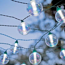 Globe Solar String Lights - These outdoor string lights have a classic look. The glass globes are iridescent so are fun even during the day time. I've always wanted to string lights on my back deck but was worried about all the cords it would take to make it happen. These are solar so I don't have to mess with horrid looking cords.