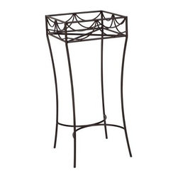 Woodard Wrought Iron Square Plant Stand - The Woodard Wrought Iron Square Plant Stand is made of handcrafted wrought iron and features decorative details on every side. The frame is purified and dipped into rust inhibitors, and then powder-coated in your choice of finish colors. Durable enough to withstand outdoor elements.Important NoticeThis item is custom-made to order, which means production begins immediately upon receipt of each order. Because of this, cancellations must be made via telephone to 1-800-351-5699 within 24 hours of order placement. Emails are not currently acceptable forms of cancellation. Thank you for your consideration in this matter.Woodard: Hand-crafted to Withstand the Test of TimeFor over 140 years, Woodard craftsmen have designed and manufactured products loyal to the timeless art of quality furniture construction. Using the age-old art of hand-forming and the latest in high-tech manufacturing, Woodard remains committed to creating products that will provide years of enjoyment.Superior Materials for Lasting DurabilityEach piece in the Classics Collection is hand-formed using solid wrought iron stock: the heaviest available. The technique used to create Woodard wrought iron furniture has been handed down from generation to generation. To this day, expert workers use anvils and hammers to forge intricate detail in the iron.Fabric, Finish, and Strap FeaturesAll fabric, finish, and straps are manufactured and applied with the legendary Woodard standard of excellence. Each collection offers a variety of frame finishes that seal in quality while providing color choices to suit any taste. Current finishing processes are monitored for thickness, adhesion, color match, gloss, rust-resistance and, and proper curing. Fabrics go through extensive testing for durability and application, as well as proper pattern, weave, and wear.Most Woodard furniture is assembled by experienced professionals before being shipped. That means you can enjoy your furniture immediately and with confidence.Together, these elements set Woodard furniture apart from all others. When you purchase Woodard, you purchase a history of quality and excellence, and furniture that will last well into the future.