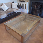 Bespoke Oak and Glass coffee table, London - Solid European Oak coffee table with 10mm thick toughened glass top bonded to stainless steel discs. The discs are recessed into the oak table to prevent the glass top sliding and add a decorative detail. Edges have a beveled decorative detail and finished in a  satin hard wax oil.