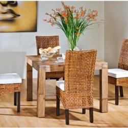 "Hospitality Rattan Pegasus Indoor 5 Piece Rattan & Wicker Dining Set with Square - Tropical doesn't have to be garish, Hawaiian shirt-styled cushions and tiki idols, sometimes it can be a simple combination of materials and styles like you'll find in the Hospitality Rattan Pegasus Indoor 5 Piece Rattan & Wicker Dining Set with Square Base - Natural - Seats 4. Each seat has a wooden frame that supports an open-lattice weave of hand-crafted wicker. Solid mahogany legs add style and durability to each chair, and the neutral-toned square cushions add plump comfort. The clear lines of the table are crafted from rattan with a crushed bamboo top and a natural finish that highlights the organic feel of this four-person set.Dimensions:Chair: 20W x 23D x 41H inchesTable: 41L x 41W x 32H inchesAbout Hospitality Rattan Hospitality Rattan has been a leading manufacturer and distributor of contract quality rattan, wicker, and bamboo furnishings since 2000. The company's product lines have become dominant in the Casual Rattan, Wicker, and Outdoor Markets because of their quality construction, variety, and attractive design. Designed for buyers who appreciate upscale furniture with a tropical feel, Hospitality Rattan offers a range of indoor and outdoor collections featuring all-aluminum frames woven with Viro or Rehau synthetic wicker fiber that will not fade or crack when subjected to the elements. Hospitality Rattan furniture is manufactured to hospitality specifications and quality standards, which exceed the standards for residential use. Hospitality Rattan's Environmental Commitment Hospitality Rattan is continually looking for ways to limit their impact on the environment and is always trying to use the most environmentally friendly manufacturing techniques and materials possible. The company manufactures the highest quality furniture following sound and responsible environmental policies, with minimal impact on natural resources. Hospitality Rattan is also committed to achieving environmental best practices throughout its activity whenever this is practical and takes responsibility for the development and implementation of environmental best practices throughout all operations. Hospitality Rattan maintains a policy of continuous environmental improvement and therefore is a continuing work in progress. Hospitality Rattan's Environmentally Friendly Manufacturing Process All of Hospitality Rattan products are green. From its basic raw materials of rattan poles, peels, leather, bamboo, abaca, lampacanay, wood, leather strips, and boards, down to other materials like nails, staples, water-based adhesives, finishes, stains, glazes and packing materials, all have minimum impact to the environment and are safe, biodegradable, recycled, and mostly recyclable. Aside from this, the products have undergone an environmentally-friendly process that makes them """"greener."""" The company's rattan components are sourced from sustained-yield managed forests, which means the methods used to grow and harvest the rattan vines ensure the long-term life of the forest and protect the biodiversity of the forest's ecosystems. Hospitality Rattan is committed to buying and using all materials, from rattan and hardwood to finishing materials, from reputable and renewable suppliers and seeks appropriate evidence that suppliers are in compliance with this policy. Hospitality Rattan strives to use materials that are processed in an environmentally responsible manner, or consist of a high level of recycled material. Finishing materials and stains used in Hospitality Rattan's furniture products consist of 75% water-based solutions which evaporate upon application with reduced or Volatile Organic Compounds (VOCs). The furniture factories use water-based glues, stains, topcoats and other finishes on all of their products. The switch from traditional solvent-based processes to water-based processes involved consolidating several processes by the factories, resulting in an 85% reduction in VOC emissions."