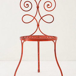 Le Versha Chair, Red - This whimsical wrought iron chair looks like it belongs in a Paris apartment. It's perfect for a small round breakfast table or a balcony.