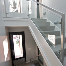Contemporary Staircase by Iron & Wire LLC