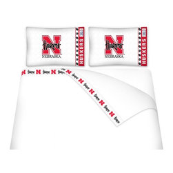 Sports Coverage - Sports Coverage NCAA Nebraska Cornhuskers Microfiber Hem Sheet Set - Twin - NCAA Nebraska Cornhuskers Microfiber Hem Sheet Set have an ultrafine peach weave that is softer and more comfortable than cotton. Its brushed silk-like embrace provides good insulation and warmth, yet is breathable.   The 100% polyester microfiber is wrinkle-resistant, washes beautifully, and dries quickly with never any shrinkage. The pillowcase has a white on white print beneath the officially licensed team name and logo printed in vibrant team colors, complimenting the new printed hems.    Features: -  Weight of fabric - 92GSM ,  - Soothing texture and 11 pocket,  -  100% Polyester,  - Machine wash in cold water with light colors,  - Use gentle cycle and no bleach ,  - Tumble-dry,  - Do not iron ,