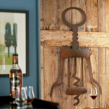 Giant Metal Corkscrew Wall Art - Opens lots of eyes and conversations. How often do you see a 4-foot corkscrew on a wall? When a 'vintage' painting just won't do choose a quirky piece of large wine art with this lightweight recycled metal sculpture to mount in the cellar the bar a restaurant or wherever a shot of whimsy is welcome. Our metal wine art wall decor also folds in half for easy storage.