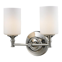 Two Light Matte Opal Glass Chrome/matte Opal Vanity - Matte opal glass shades rest elegantly upon beautifully designed hardware that is finished in chrome, creating a look that is uniquely modern. This two light vanity fixture will add a touch of modern class where ever it is hung.