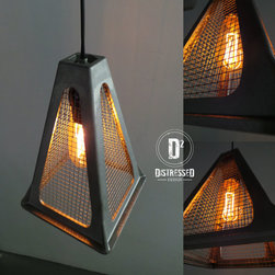 Pendant Lighting - The pendant light is made from a repurposed trailer jack and salvaged mesh wire. This would be a great look in an industrial space, or bring a modern touch into any home.