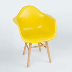 "Shaker Arm Chair in Mustard - Some designs were ahead of their time. Considered the chair of tomorrow in both its design and in the way it was first manufactured in a single mold, the Shaker Arm Chair is inspired by one of the most iconic mid-century furniture designs. Created in the spirit of economy and affordability, its unique shape was designed to spread the sitter's weight and pressure evenly. The deep seat and waterfall edge provide additional comfort as the design shapes itself around the body's curves, while its classic wooden base adds stability and a more traditional note. If you've done away with formality in your home, the Shaker Arm Chair is that one piece of furniture that exemplifies the ""less is more"" ethos. It's the ultimate seat that goes well in a variety of different settings: as a home office chair, an entryway slipper seat, or that one statement piece in the living room."