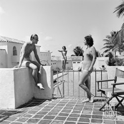 1930s Man Woman Wearing Bathing Suits on Terrace Overlooking Swimming Pool Woman -