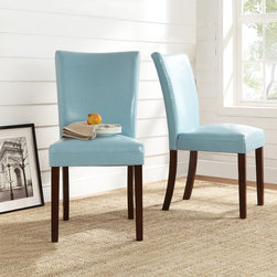 Tribecca Home - TRIBECCA HOME Estonia Sky Blue Upholstered Dining Chairs (Set of 2) - Add a little flair to your dining room or seating area with these sky blue parson chairs. Instantly update your space with these poplar wood and faux leather chairs. The faux leather features makes for easy cleaning and kid-friendly seating.