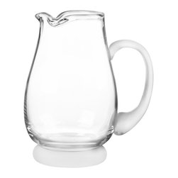 Qualia - Arctic Pitcher - Hold and pour your beverages using the sleek Arctic Pitcher. Its clean lines, wavy mouth and white handle and base give the piece a simple, elegant look. Display it alongside other modern design elements for a cohesive feel.