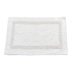 "Large-Sized, Reversible Cotton Bath Mat in White - White 100% Cotton Reversible Bath Mat, Size 21""x34"". This Large-Sized (21'' w x 34'' l), 100% Cotton Bath Mat is Reversible, allowing you to restore your bath mat's freshness and cushiness with a simple flip. Soft, absorbent, machine-washable and ever so durable, this mat can endure its share of stamping and trampling. Here in White, this product is available in a variety of fashionable colors and a smaller (17'' w x 21'' l) size. Machine wash in warm water, line dry, reshape as needed"