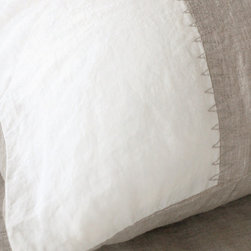Luka - Striped Sham - A center inset of lovely, naturally variegated flax linen is stitched between bands of snow white on each Luka Pillow Sham.  Designed to match everything while still having personality and complete, room-finishing style, this sham is made from two colors of certified organic linen top-stitched together with natural-colored zig-zag embroidery.  The cover's back is in the lovely natural shade.  Pair the Luka Sham with the matching duvet for instant sleek, practical drama.