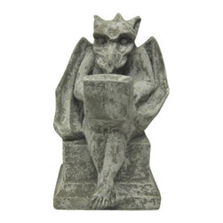 Gargoyle With Laptop Computer Concrete Statue - This cool solid concrete statue combines the present and past, featuring a winged gargoyle typing away on a laptop computer. The statue measures 7 1/2 inches tall, 5 inches wide and 4 1/2 inches deep. Since it`s made of concrete, it can be used indoors or outdoors, and looks great in garden, patios, garden, even bedrooms. It`s great for anyone with a slightly bent sense of humor.