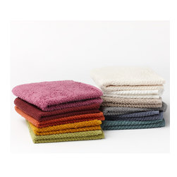 "Coyuchi - Coyuchi Air Weight Wash Cloth - The Coyuchi air weight wash cloth exudes sumptuous comfort. Light yet plush, the medium-weight accessory features a textured twill weave rich with luxurious and absorbent texture. 12""W x 12""H; 100% organic cotton terry; Available in several colors; Machine washable"