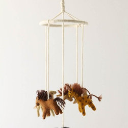 "Felt Safari Mobile - This hand-crafted wool felt mobile is a brilliantly unique addition to a safari-themed nursery. These quaint animals come together into one delightful and simple whole, bringing out a roar of delight in your little lion.Wool24""H, 6.5"" diameterHandmade in Nepal"