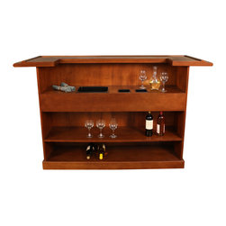 American Heritage - American Heritage Lexington Bar in Suede - The Lexington Bar is incredibly versatile and will blend beautifully will any homes decor. The decorative raised panels in a suede finish add regal and warmth to this stately piece. Open shelving designed to hold bottles, glasses and mixing supplies allows for maximum storage of all your barware. No need to run back and forth to the kitchen during your next social.