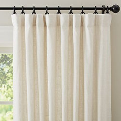 """Emery Linen Pole Pocket Drape, 50 x 108"""", Ivory - The soft, nubby texture of our Emery Linen Drape brings a casual warmth to the room. Yarn-dyed, these new linen/cotton blend drapes are made with two different colored threads, creating soft, subtle texture - and the pure cotton lining helps diffuse light just right. You can choose to hang the drape from the pole top, back loop or ring top. 50"""" wide; available in five lengths Made of a linen/cotton blend; with flax fibers imported from France. Cotton lining. Detailed with blind-stitched hems. Hangs from the pole pocket, or from concealed fabric loops in back for a more tailored look. Converts to ring-top style with the included drapery hooks. Use with 9 Clip or Round Rings (sold separately). Use with our Blackout Liner (sold separately) for enhanced light filtration. Dry-clean. Imported."""