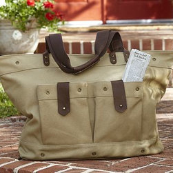 """Waxed Canvas & Leather Weekender Bag - Made of cotton canvas with genuine leather straps and a striped lining, this weekender bag allows you to travel light and in style. Three large pockets, one inside and two outside, allow you to keep your most essential items neatly organized and near at hand. 19"""" wide x 8.5"""" deep x 16"""" high Made of 16-ounce cotton canvas with PVC coating. Twill cotton lining, leather straps and brass-finished zippers. Two exterior pockets and one interior pocket. Monogramming is available for an additional charge."""