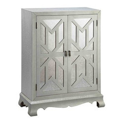 Stein World Orick 2-Door Mirrored Cabinet - Add a little polish to any room in your home with the Stein World 12626 Orick 2-Door Mirrored Cabinet. Mirrored doors add a touch of elegance to the piece, while geometric fretwork provides a stunning detail. Two doors open to reveal storage for anything you choose. The simple, clean design and sleek, silver finish are right at home with styles from traditional to modern.About Stein WorldStein World is dedicated to discovering and bringing to the market place the finest hand-painted products from around the world. With over 50 years of experience, they have been able to develop not only the resources but true partnerships with quality manufacturers and artisans who make Stein World unique in the furniture industry today. Their commitment to you is to present only the highest quality furniture at prices that bring future family heirlooms into everyone's price range.