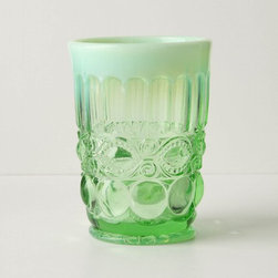 Opalescent Tumbler, Green - Yes, this would make a lovely drinking glass, but you know what I would do with it? Candles! Can't you picture a little tea light in the bottom, twinkling against the raised glass and throwing fun patterns of light on the table?
