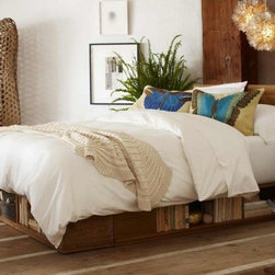 Viva Terra - Storage Bed - Light (cal king) with White Glove Delivery - Hiding in plain sight has definiteadvantages, especially when spaceis at a premium. The six cubbiesin our handcrafted Douglas firbed neatly tuck away blankets,books and sundry items. Eliminatingclutter, they keep youorganized so you can sleep inpeace on this sturdy platform bed.Offered in three hand-waxed, alleco finishes (see page 33). Made inUSA. Assembly required.