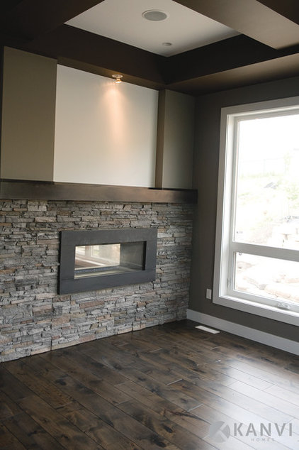 contemporary fireplaces by Kanvi Homes