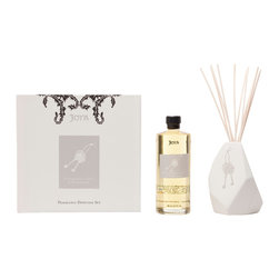 Joya - Pomegranate, Laurel & White Pepper Diffuser Set - Golden pomegranate, oak moss, juniper twig and wild ginger combine to create a fragrance unlike any other. Holding these exquisite scents together is an asymmetrical ceramic vase, designed in partnership with artist Sarah Cihat and featuring a double-key motif.