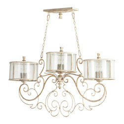 Kathy Kuo Home - Florent French Country White 9 Light Island Chandelier - Scroll on!  We love the artistic metalwork and trio of seeded glass lanterns which make this piece so unique and covetable. Typical of French Country style lighting, this piece would work beautifully over a large dining room table, kitchen counter or entryway.