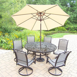 Oakland Living - 9-Pc Patio Dinning Set - Includes table, six swivel rockers, 9 ft. tilt crank umbrella with stand and metal hardware. Traditional lattice pattern and scroll work. Hardened powder coat. Handcast. Fade, chip and crack resistant. Warranty: One year limited. Made from cast aluminum and sling. Black color. Minimal assembly required. Table: 60 in. Dia. x 29 in. H (70 lbs.). Swivel Chair: 24 in. W x 30.5 in. D x 40 in. H (16 lbs.)The Oakland cascade collection combines contemporary style and modern designs giving you a rich addition to any outdoor setting. We recommend that the products be covered to protect them when not in use. To preserve the beauty and finish of the metal products, we recommend applying an epoxy clear coat once a year. However, because of the nature of iron it will eventually rust when exposed to the elements.