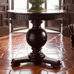 Tommy Bahama Home - Marigot Center Table - True Wood framed. Antiqued mirrored top. Made from mahogany solids, American maple and mahogany veneers, metal, antiqued stone, hammered copper, woven cane and hand-tooled leather. Tamarind - black, highly distressed finish. Minimal assembly required. 36 in. Diameter x 30 in. H (100 lbs.). Assembly Instructions. Special Care Instructions from Lexington FurnitureKingstown is a relaxed traditional collection inspired by British Colonial style, with a hint of Campaign and a touch of safari. The Tamarind finish is a rich aged black with rub-through to crimson and gold undertones beneath. The evocative designs provide a sense of a well-traveled life.of items hand selected during journeys around the globe. Each piece is crafted as a one-of-a-kind find yet the eclectic collection coordinates beautifully. Travel the world without ever leaving home.