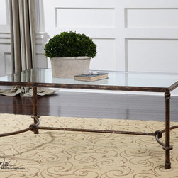 """Uttermost - Warring Iron Coffee Table - Inspired By Ancient Horse Bridles, This Forged Iron Coffee Table Is A Blending Of Rings And Curves Finished In Rustic Bronze Patina. The Top Is Made Of Clear, Tempered Glass. Uttermost's Tables Combine Premium Quality Materials With Unique High-style Design. Bulbs included?: NO; Overall Dimensions: 28""""D x 48""""W x 20""""H"""