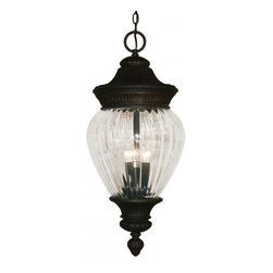 Three Light Black Gold Clear Ribbed Optic Glass Hanging Lantern - Sophisticated and classic, this large outdoor chain hung fixture is a truly elegant piece. Comprised of cast aluminum (which can endure all seasons), this fixture uses clear beveled glass a combination with a fixture that is highly detailed and finished in black gold, to create a tribute to classic elegance. Select parts of this fixture are hand cast in order to ensure the overall strength of this wonderful fixture.