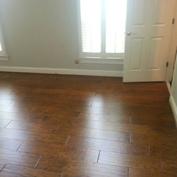 Redoing childrens rooms from carpet to hardwood flooring - Long Length Wide Width handscraped hickory engineered hardwood flooring.