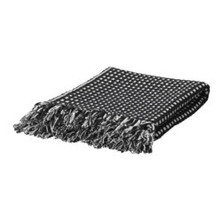 Vilmie Rund Throw - I love the dots in this simple throw. It's incredibly affordable and great for any space.